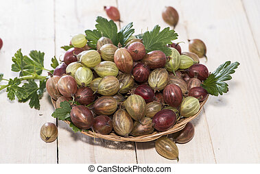 Gooseberries - Portion of Gooseberries on bright wooden...