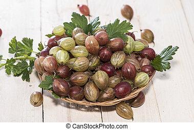 Gooseberries - Portion of Gooseberries on bright wooden...