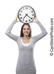 Woman smiles with a clock above her head