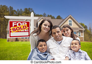 Hispanic Family, New Home and Sold Real Estate Sign - Young...