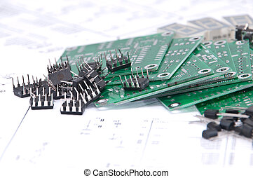 Circuit boards and components with schematics in background...