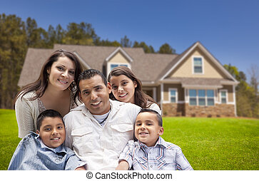 Young Hispanic Family in Front of Their New Home - Happy...