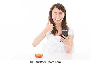 woman who see a smart phone - Beautiful young asian woman...