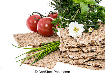 Crispbread with fresh Herbs on white