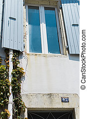 Old window and shutters in rural france