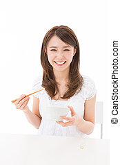 woman who eats - young attractive asian woman who eats