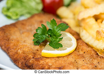 Schnitzel with Chips - Fresh made Schnitzel with Chips macro...