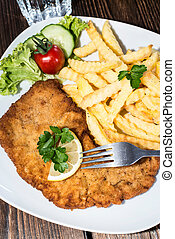 Schnitzel with Chips - Wiener Schnitzel with Chips on a...