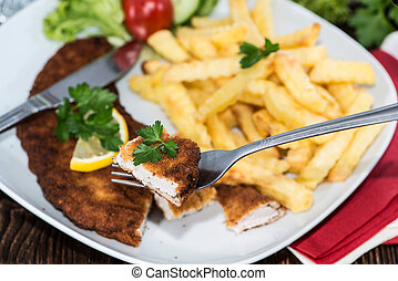 Wiener Schnitzel with Chips on a plate