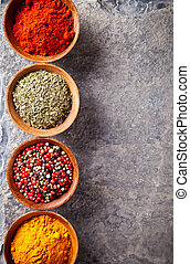 Spices - Various spices in wooden bowls