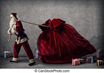 Santa Claus pulls a huge bag of gifts lying around boxes...