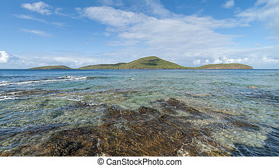 Cayo Luis Pena across the calm turquoise waters off the...