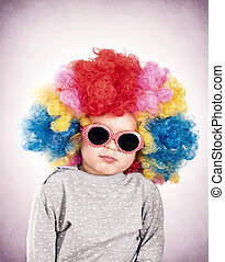 Seriously kid with sunglasses and clown wig