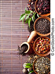 Various dry tea in small bowls - Dry tea in bowls shot from...
