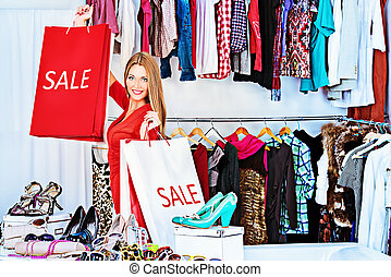 spending money - Fashionable girl shopping in a store.