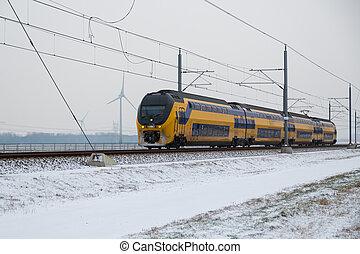 Train in Dutch rural winter landscape