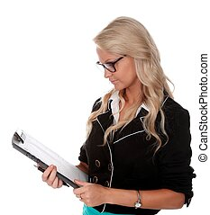 Pretty Businesss Woman wearing specs and holding clip board