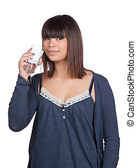 Young woman holds a glass water