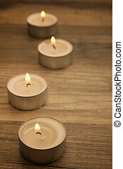 tealights - several tealights with wooden background