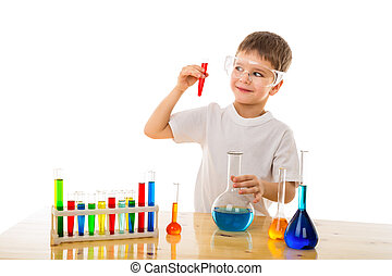 Boy making chemical experiment - Smiling boy making chemical...