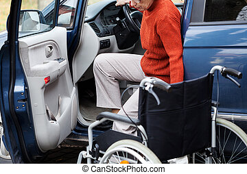 Disabled in car - Disabled elder person driving car alone