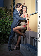 Love on the street - young man wants to kiss his girlfriend...
