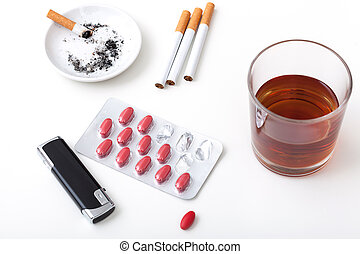 Alcohol cigarettes pills - A glass of whiskey, cigarettes,...