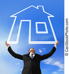 Real estate Concept - Business man holding New house...
