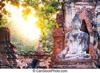 Buddha and sun light at Wat Mahathat, Ayutthaya, Thailand....