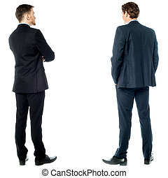 Back pose of handsome young corporates - Two businessmen...