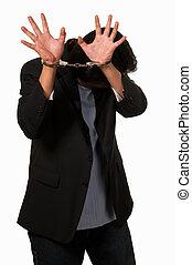 Ashamed man in handcuffs - Brunette man in handcuffs hiding...