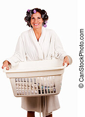 Laundry day - Happy smiling brunette woman in a robe holding...