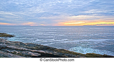 Dawn at Pemaquid Point Maine - Dawn with a mottled sky in...