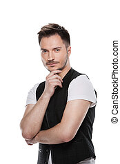 Portrait of Handsome male model posing on camera. Standing isolated over white background