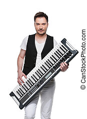 Sexy handsome man with synthesizer. Standing isolated over white background