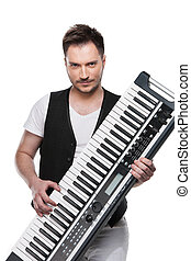 Portrait of sexy mature man with piano keyboard. Standing isolated over  white background