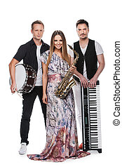 Fashionable music band posing full length over white background. Two handsome man and beautiful sexy woman with music instruments