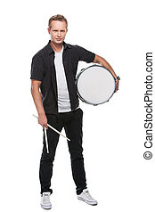 Sexy blond male drummer looking at camera. Holding white...