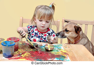 Two year old girl painting - A two year old little girl,...