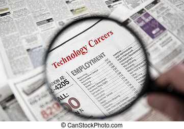 Tech jobs - Magnifying glass over a newspaper classified...