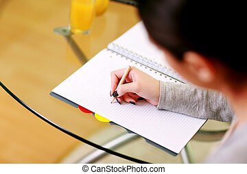 Closeup portrait of a female hand writing notes