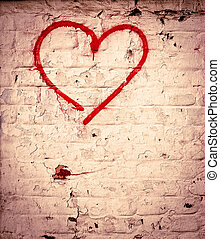 Red Love Heart hand drawn on brick wall grunge textured...