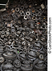 Old machine parts in second hand machinery shop in...