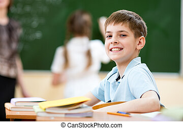 School boy in classroom at lesson