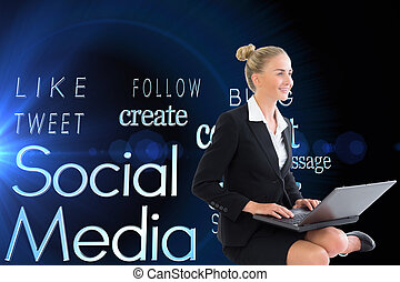 Composite image of businesswoman using laptop - Composite...
