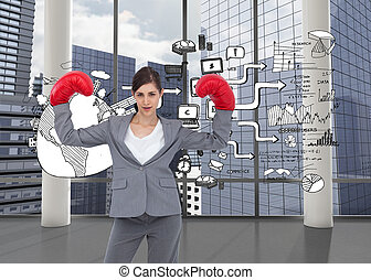 Composite image of businesswoman with boxing gloves