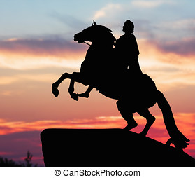 Monument of Peter Great, silhouette against the sunset St...