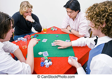 Private poker game - Three poker players and one dealer at a...