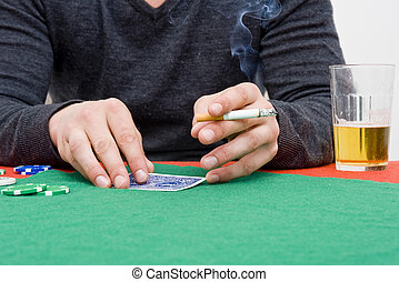 Back room poker - A player during a back room poker game...