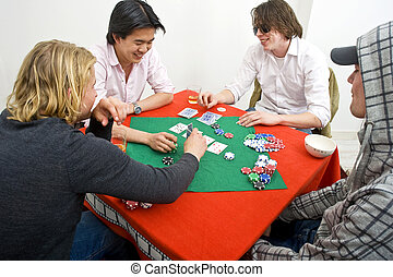 A friendly game of backroom poker - Four men playing a...